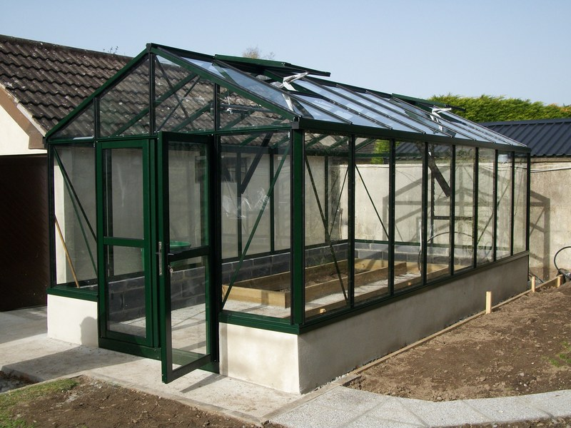 3.1m x 4.58m Helios Greenhouse on a Dwarf Wall